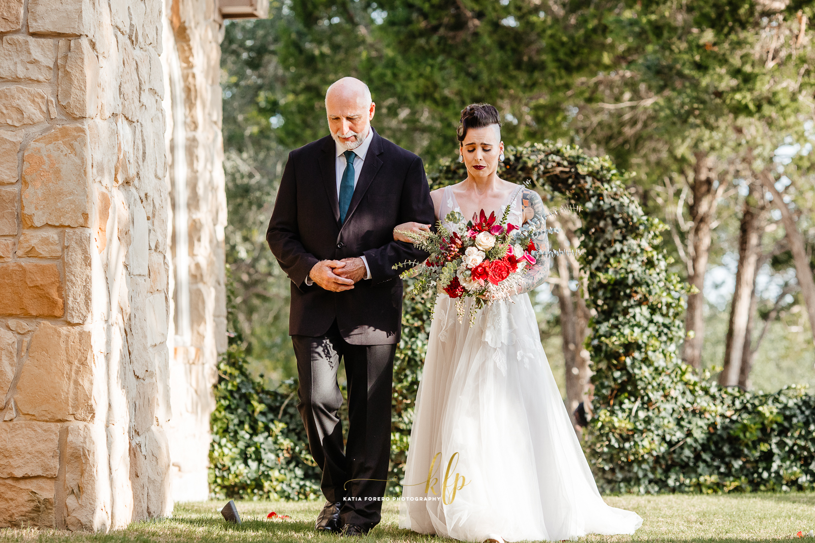 bride and dad walking