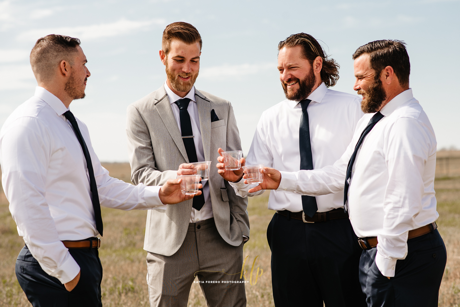 cheers groom and groomsmen