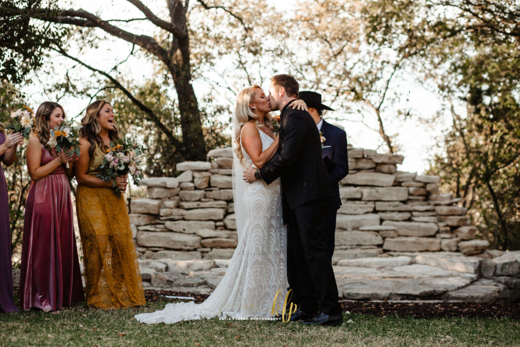 first kiss in an outdoor wedding ceremony