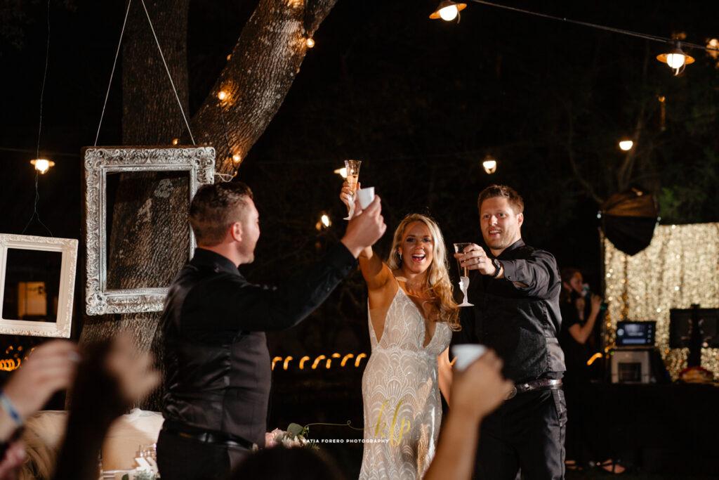 celebrating outdoor wedding reception